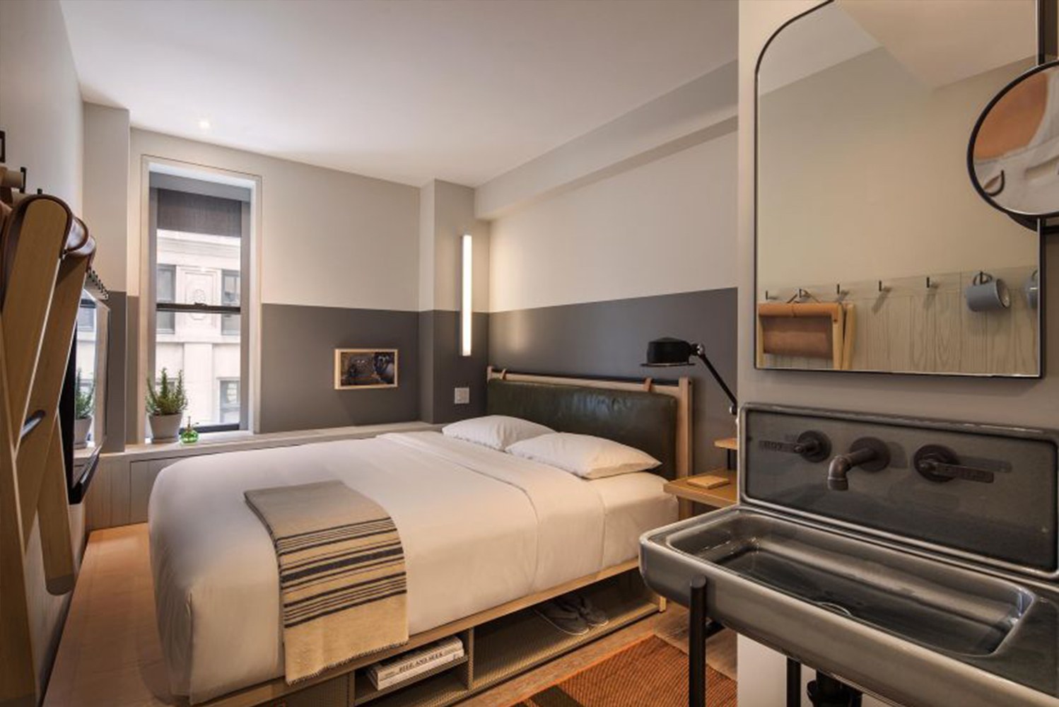 From king suites to quad rooms with twin bunks, all rooms include Yabu Pushelberg-designed foldaway furniture, walk-in rain showers, wood-frame beds with storage, and open pegboard closets.