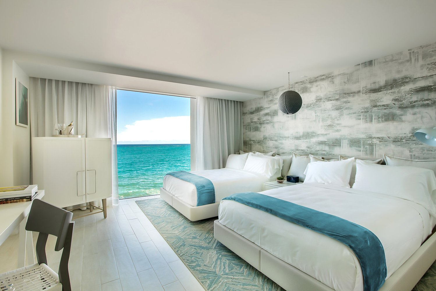 The property will have 96 rooms that will have floor-to-ceiling windows to offer views of the Atlantic Ocean or the neighboring Laguna del Condado.