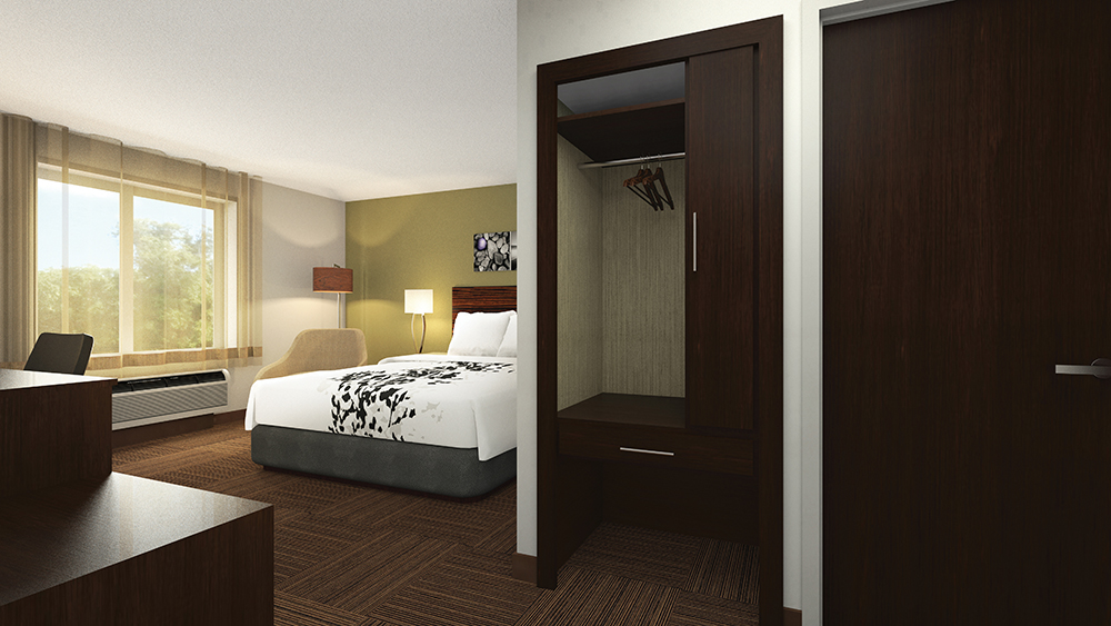 """Partially open"" closets are a key feature of the new guestroom design."