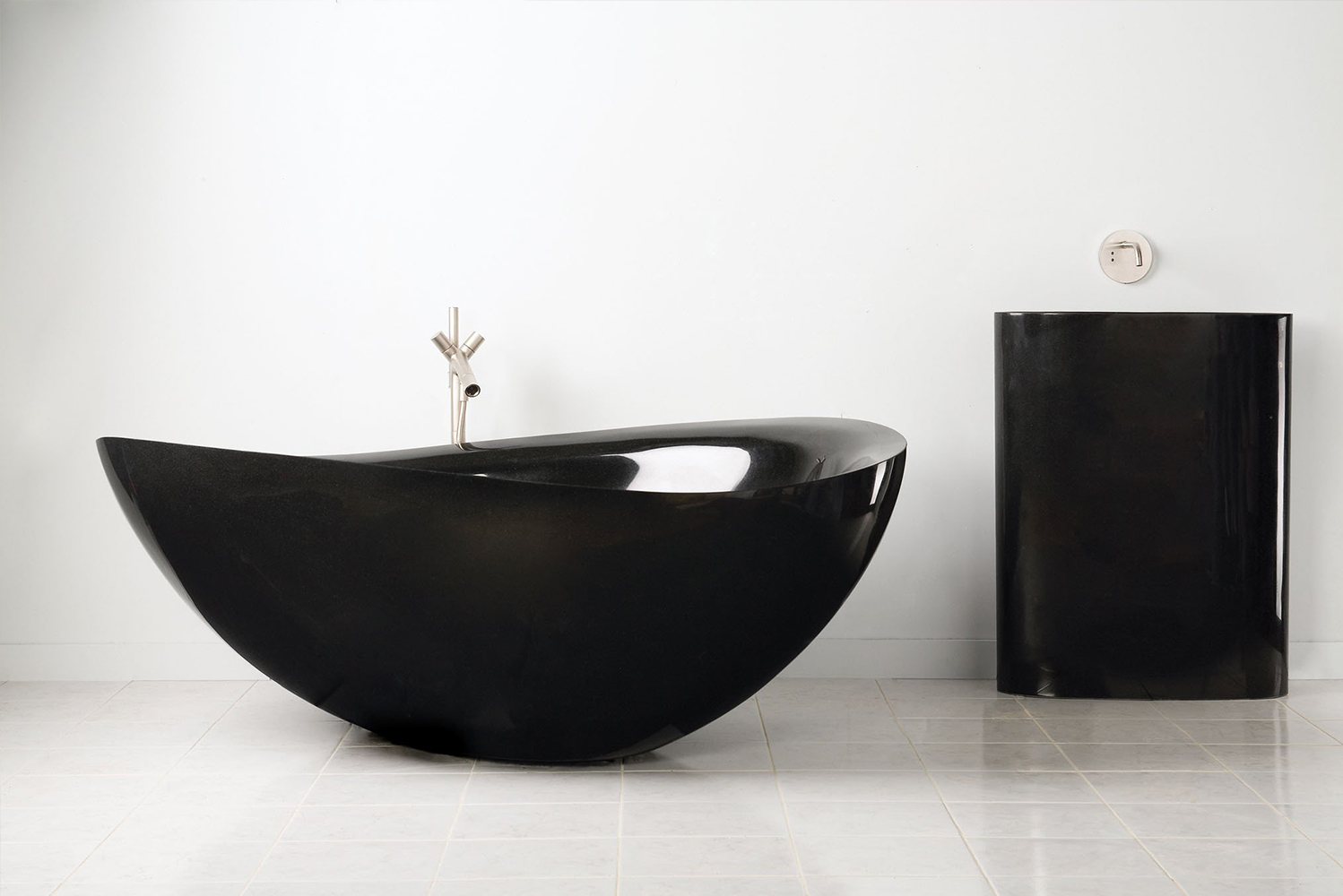 The piece features a unique shape that enables the bather to slip into it.