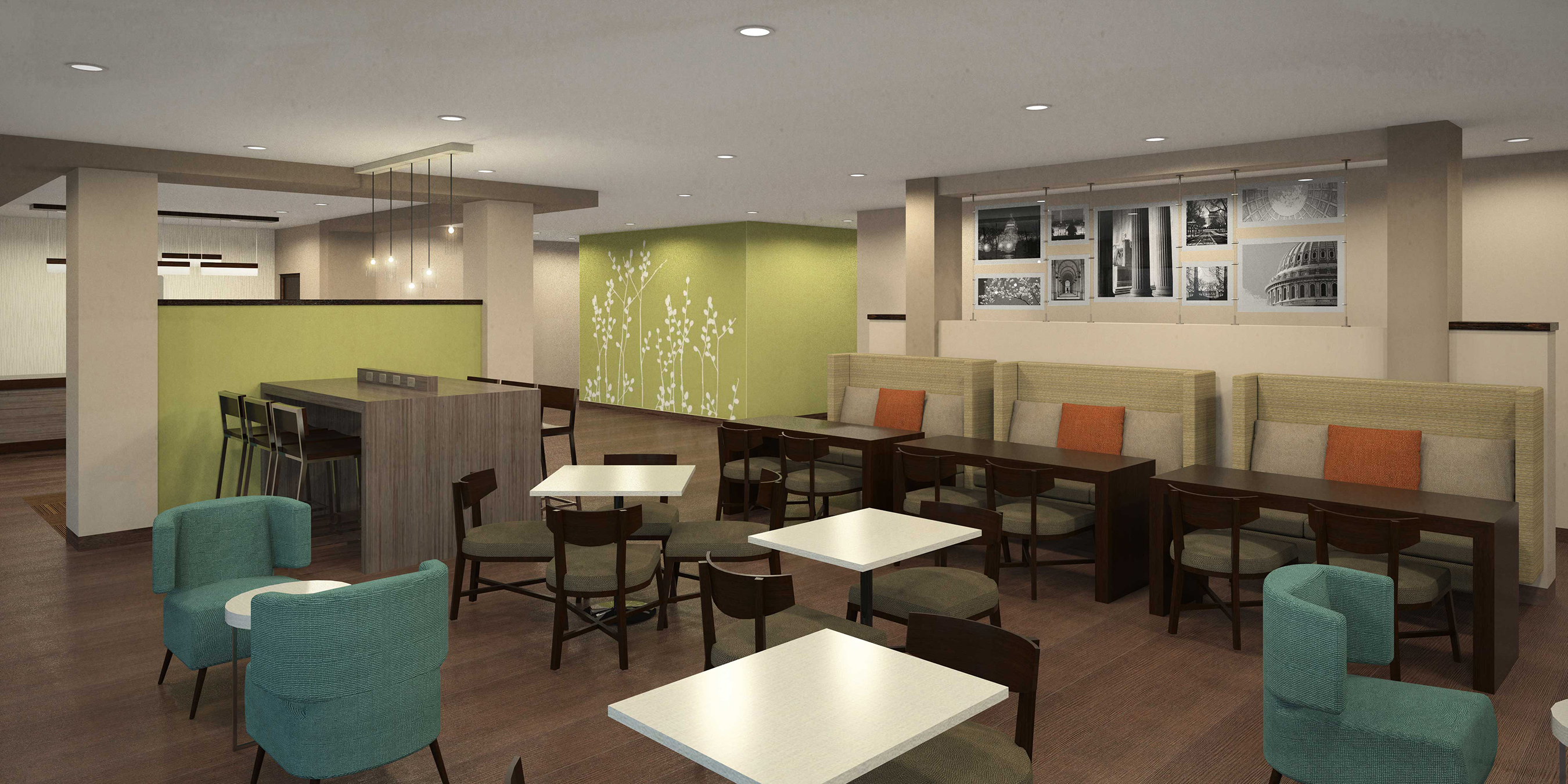 Sleep Inn lobbies have a communal table with built-in charging capabilities along with semi-private banquettes.