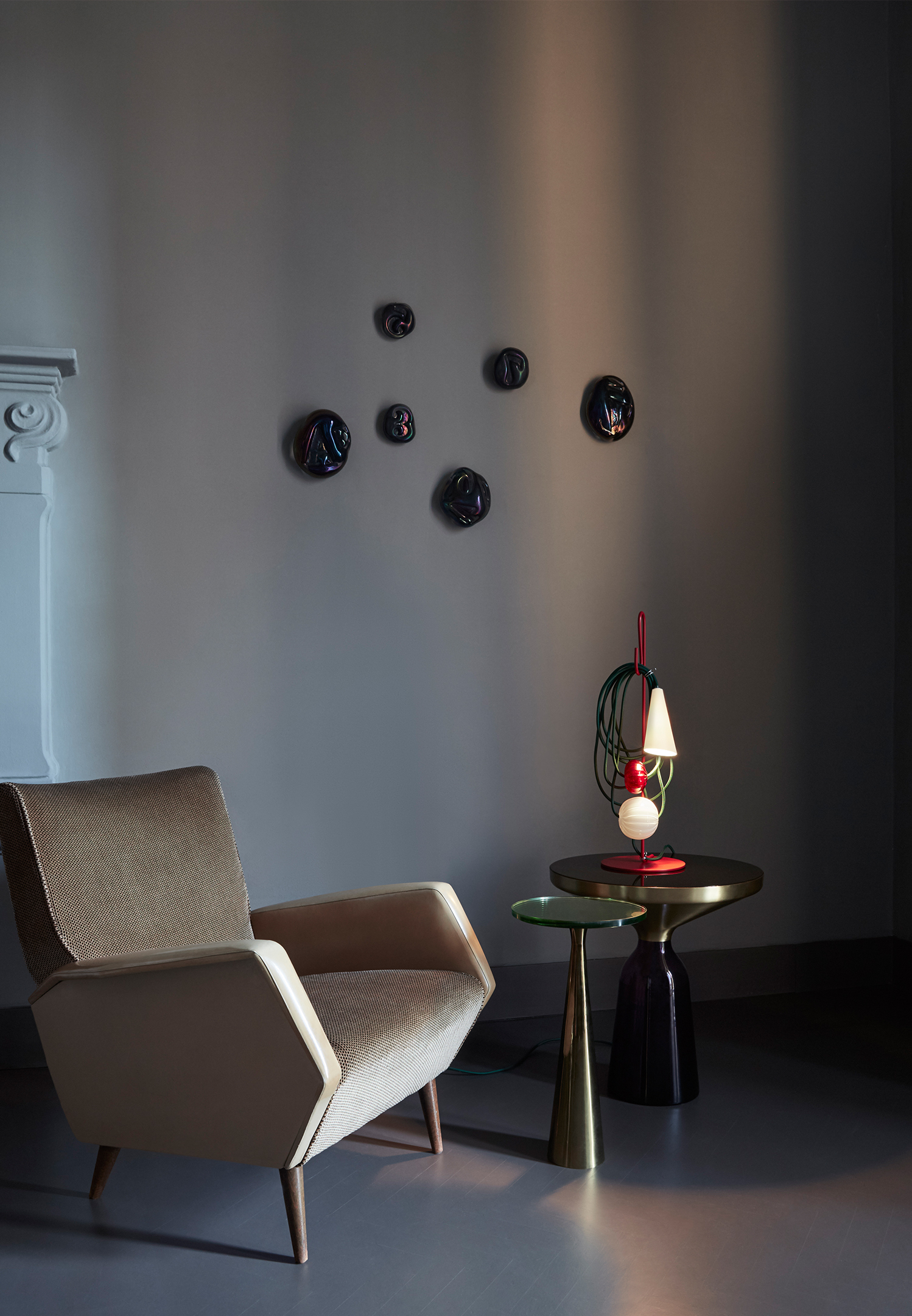 The table lamp was inspired by the idea of deconstructing the traditional lamp form.