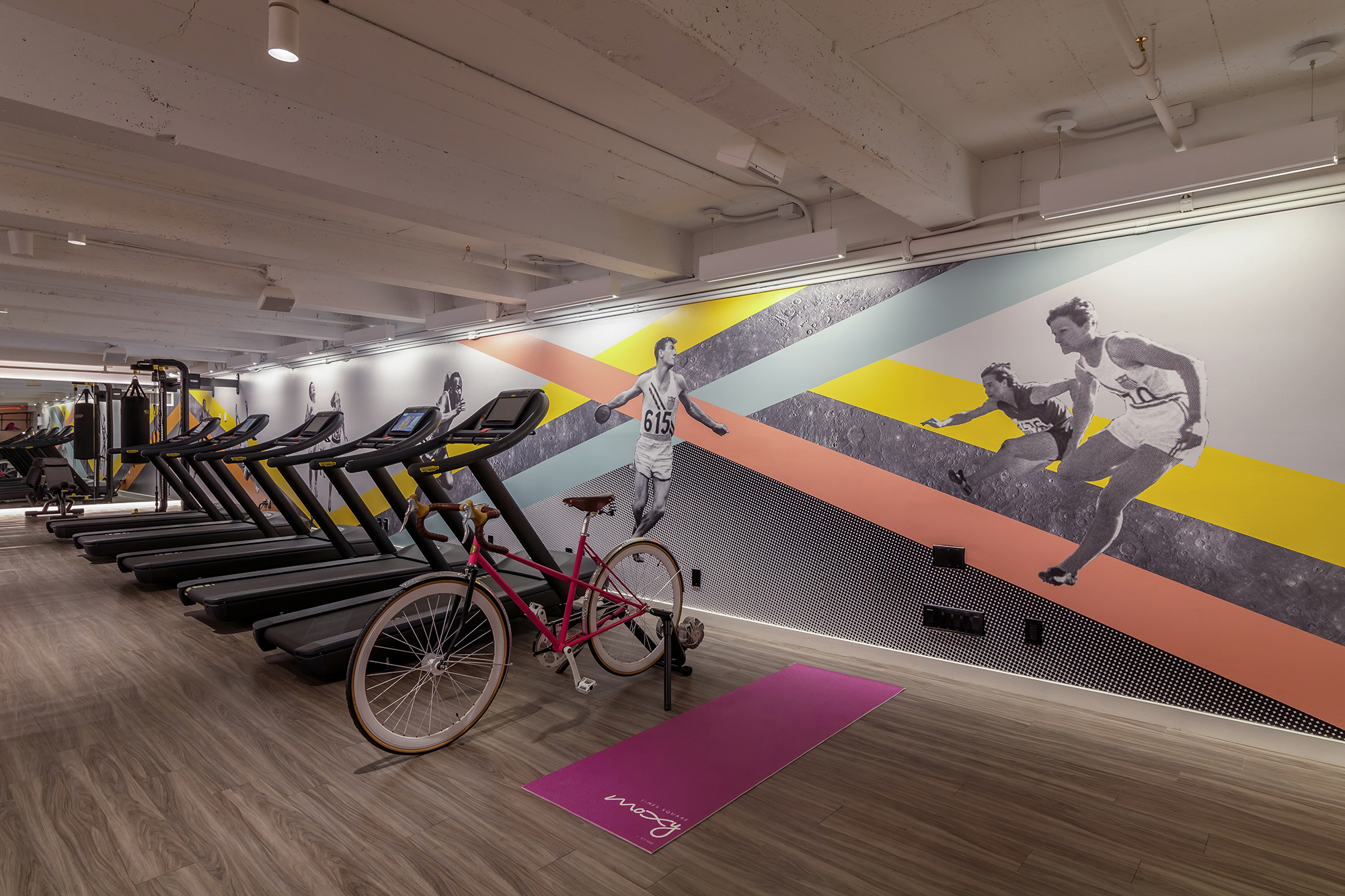 "In the Moxy's fitness center, Indiewalls worked with Stonehill Taylor to make what the company called ""a contemporary twist on vintage motifs."""