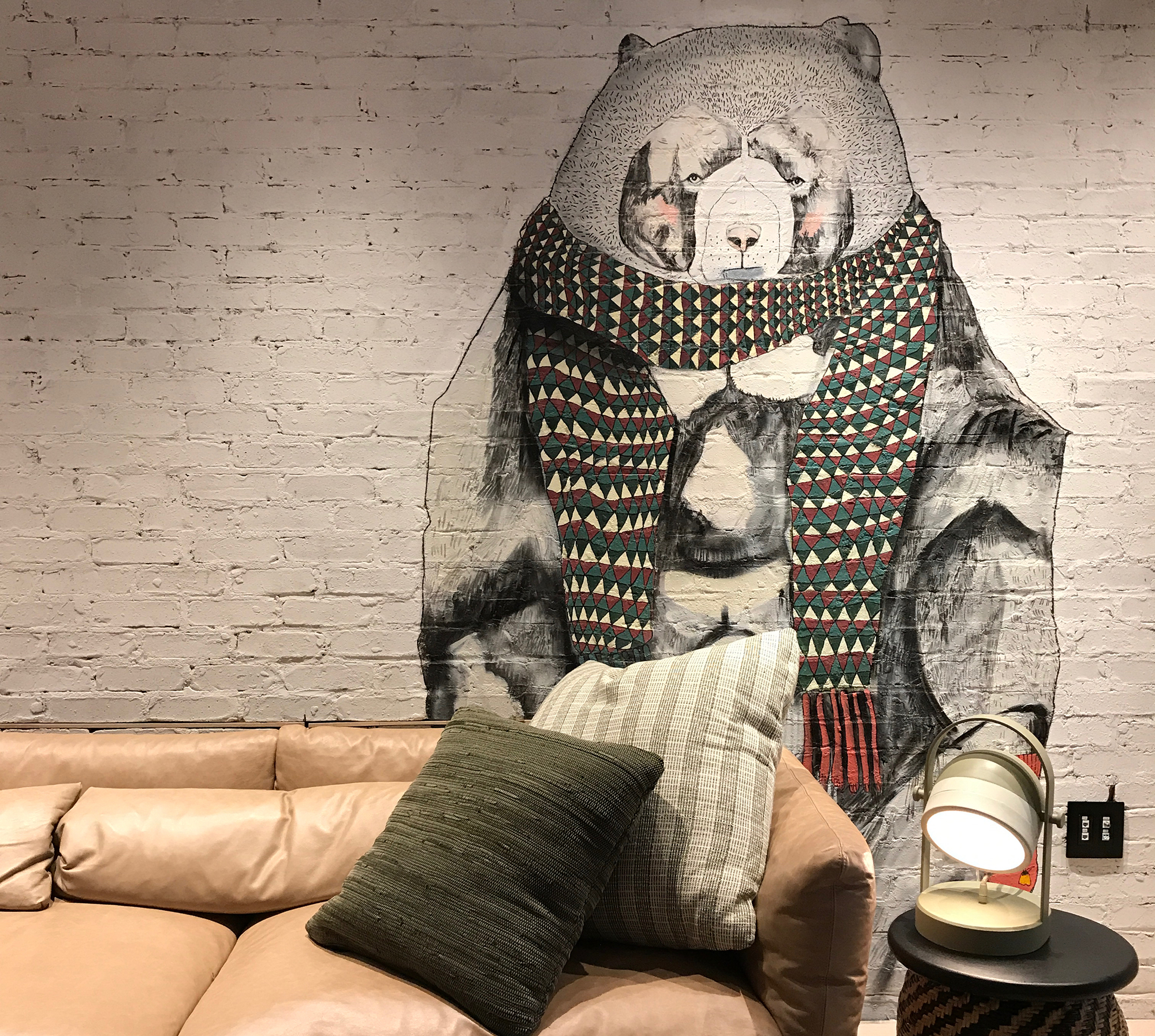 "Potts' illustration fit into the hotel's design scheme from a color perspective while the subject matter—""a bundled, welcoming, burly bear""—connects with Moxy's brand."