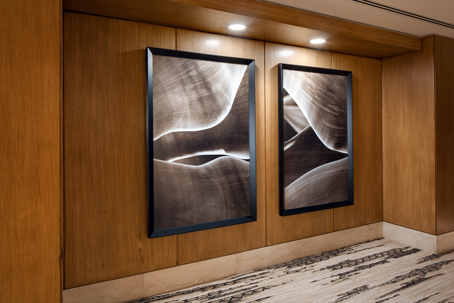 There are also wall-hung artwork with black and white strokes.