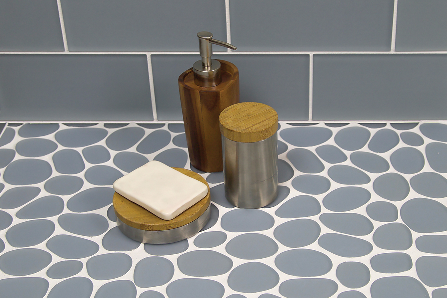 The tiles combine the comfort of a flat, matte mosaic with the shapes and organic style of stone pebbles.