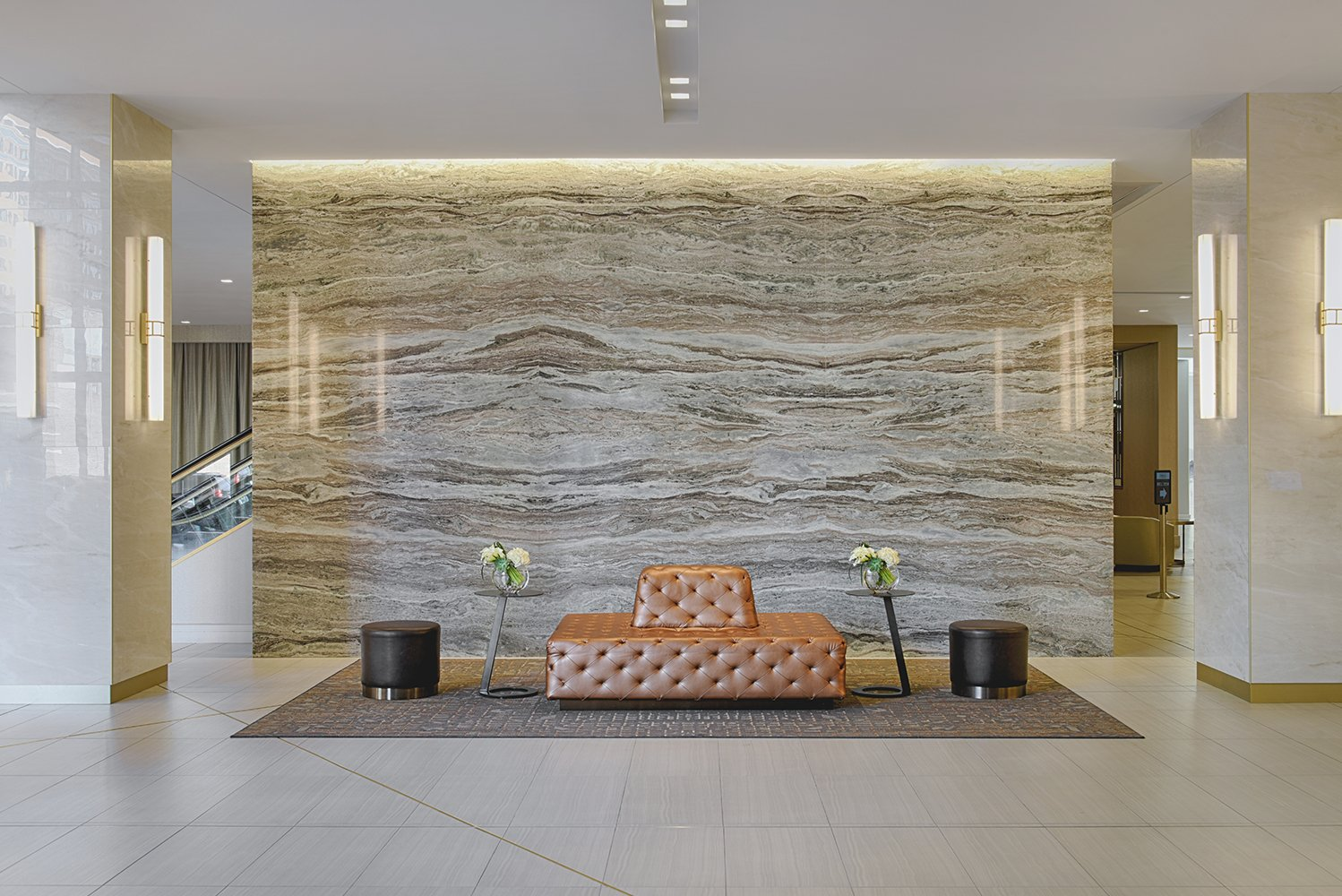 The lobby has lounge seating and communal tables.