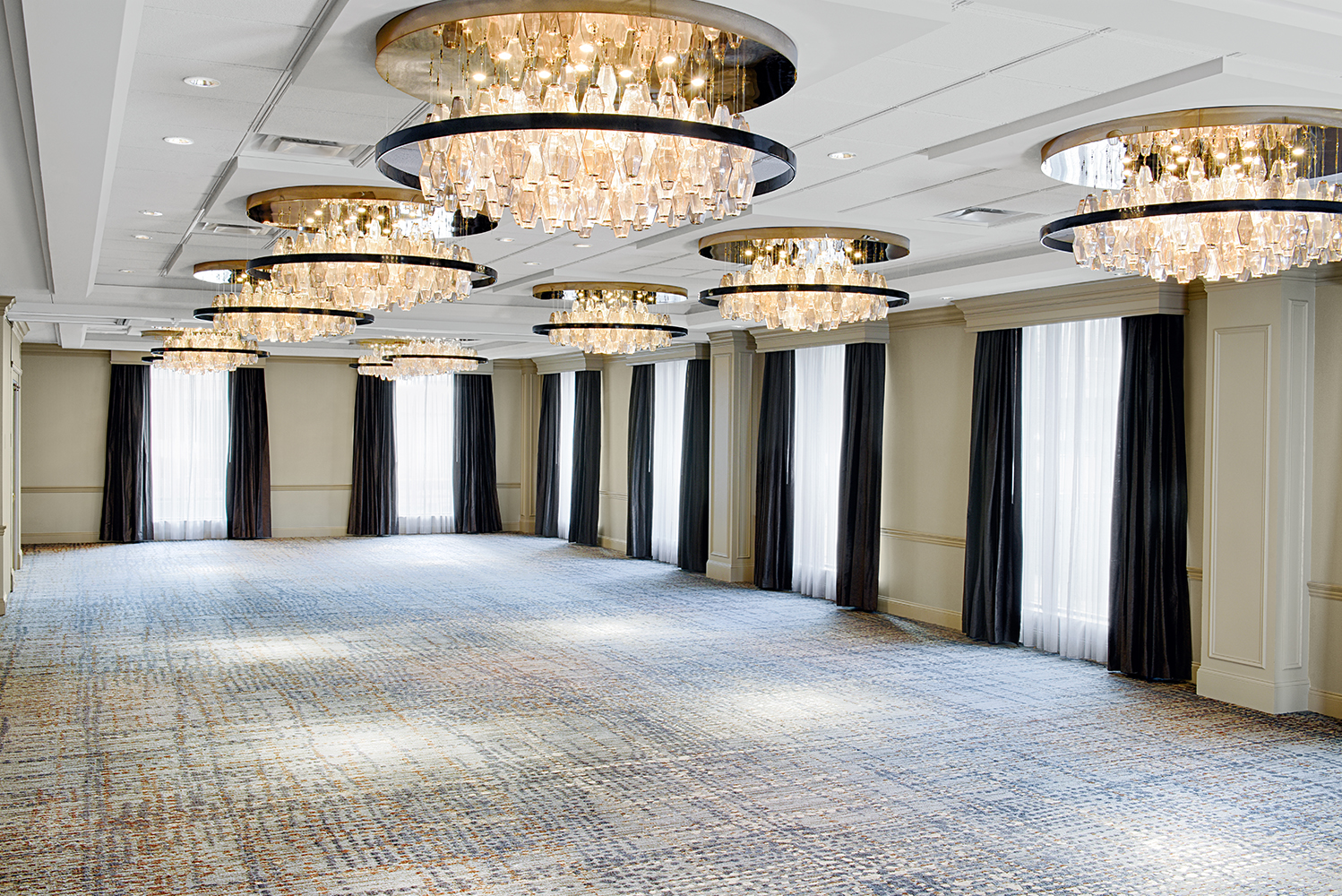 The pre-function gathering area now has seating groups and nesting tables, while the ballroom was enhanced with new chandeliers.