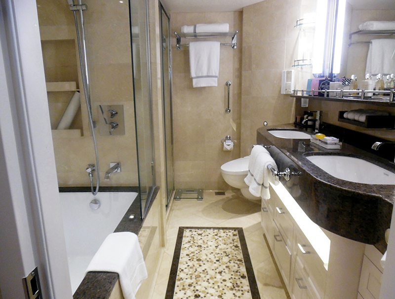 Second Bedroom: This luxurious private bathroom has marble, dual sinks, a soaking tub and separate shower.