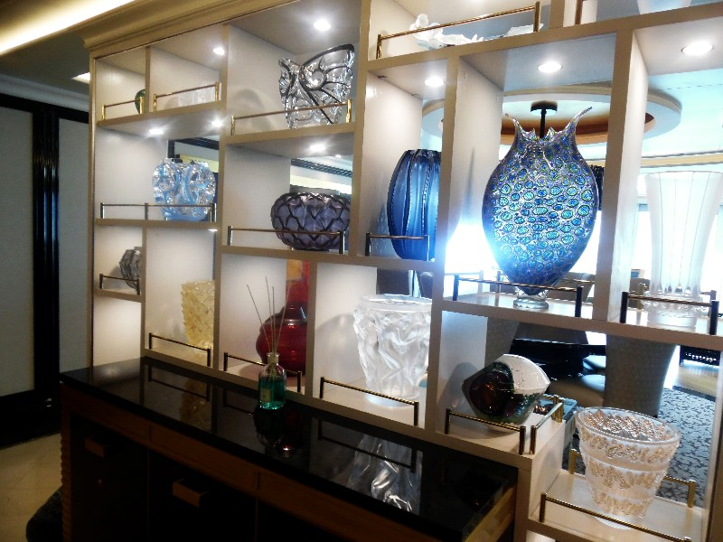Guests entering the Regent Suite first encounter this stylish credenza displaying creative Murano glass pieces.