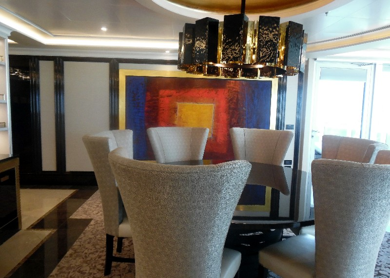 Just beyond the credenza, the dining room features comfortable seating for six.
