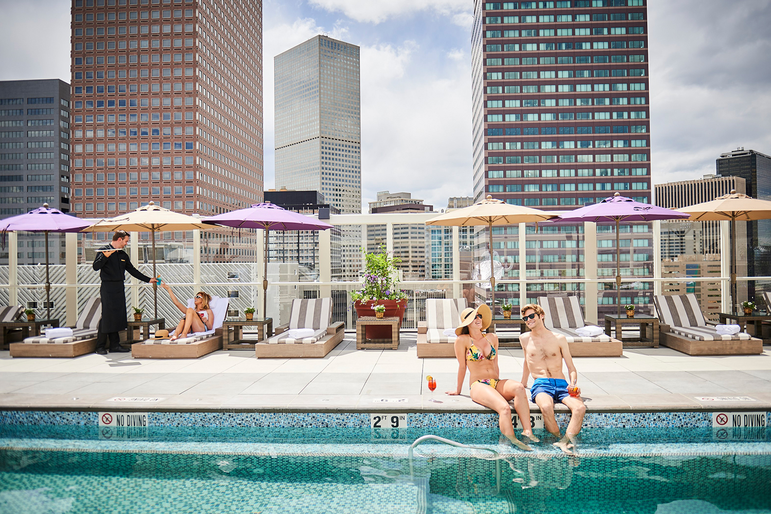 The Warwick Denver has a rooftop outdoor heated swimming pool and sun deck rooftop bar with views of the city and the mountains.