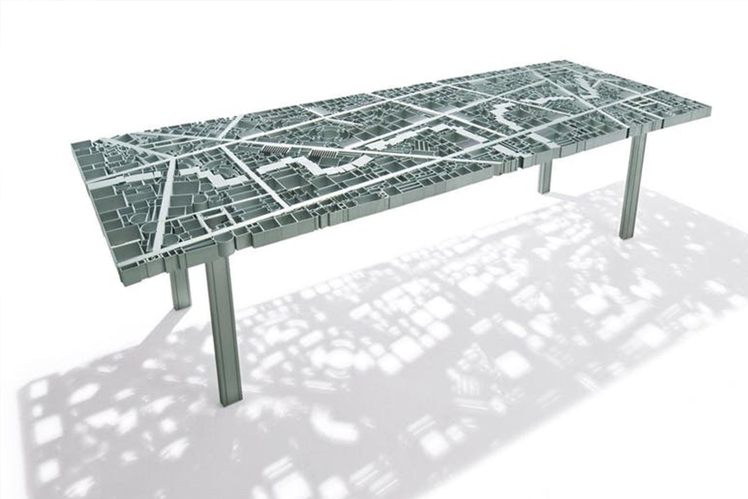 Edra launched Baghdad, a manually welded anodized aluminum table in the form of a city map.