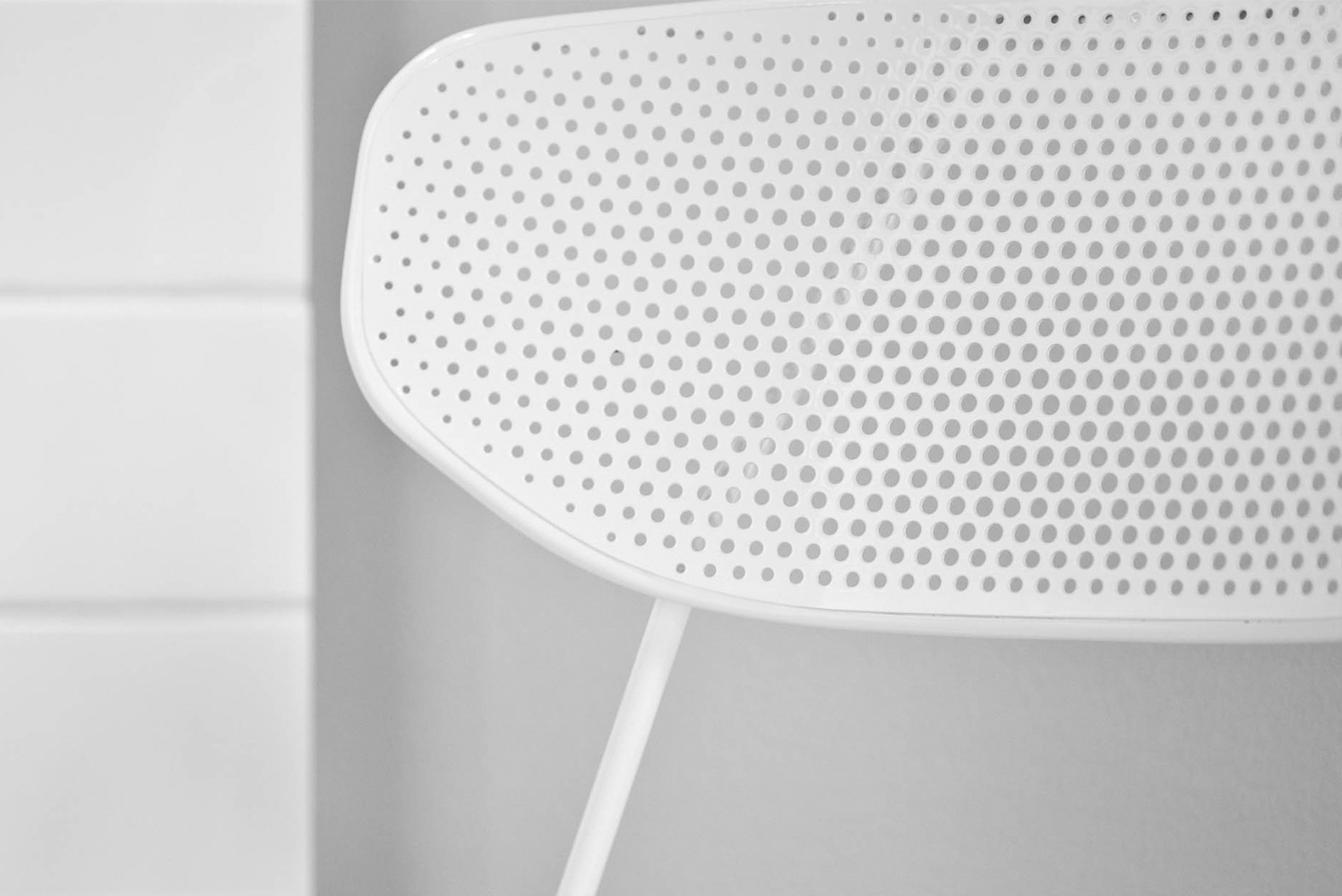 Manufactured with a powder-coated frame, the Naked chair has a perforated steel seat and backrest.