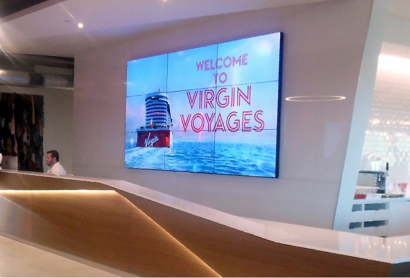 Reception desk of the new Virgin Voyages headquarters' offices in Plantation, FL.
