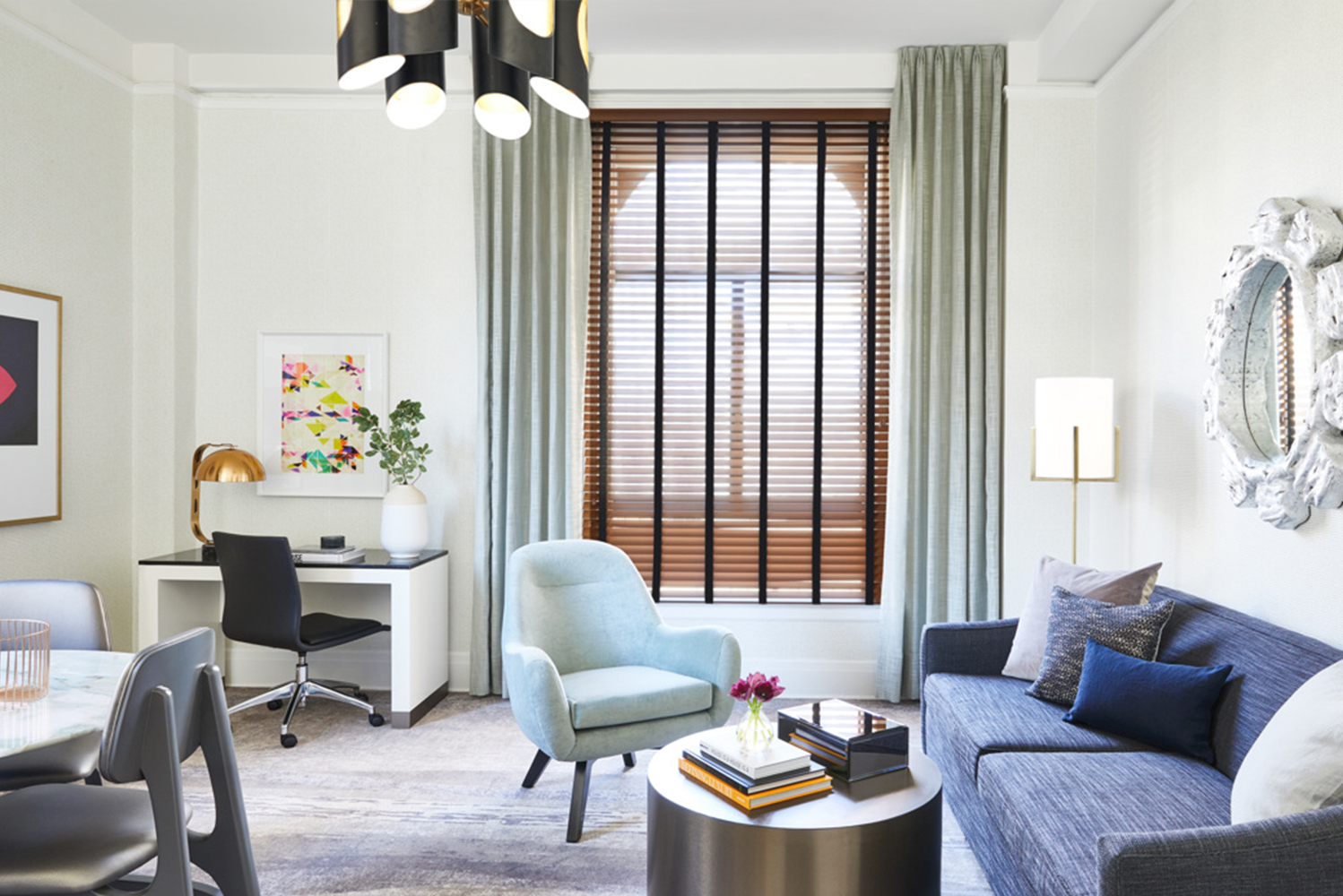 "Following the renovation, the guestrooms now have custom furnishings, a palette of neutrals, marble-topped desks and ""splattered"" antique mirrored surfaces."