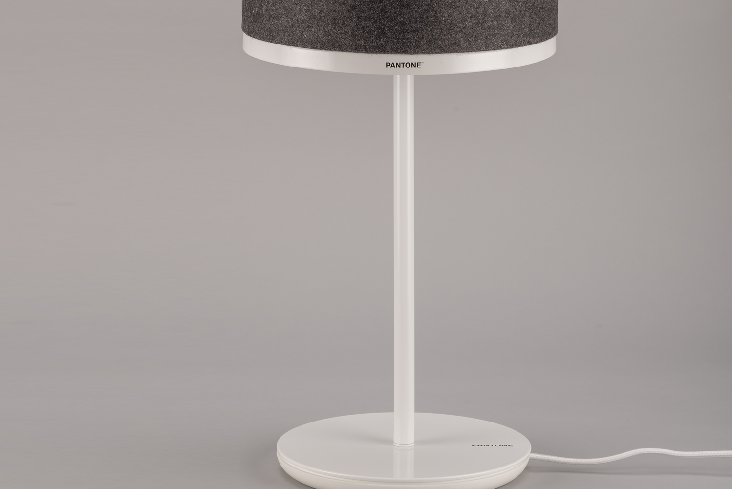 The Capella table lamp has a specially designed base that appears lightweight