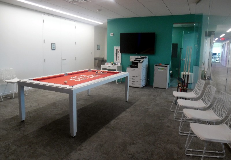Employees can enjoy billiards while waiting for the copy machine to finish its task.