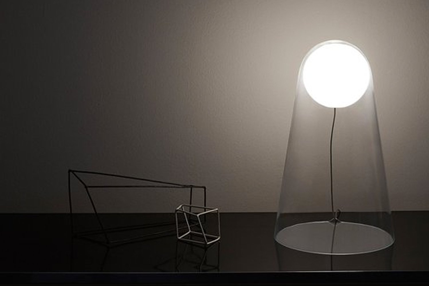 Satellight has a LED lamp containing a milky white diffuser that is encapsulated inside a clear piece of glass.