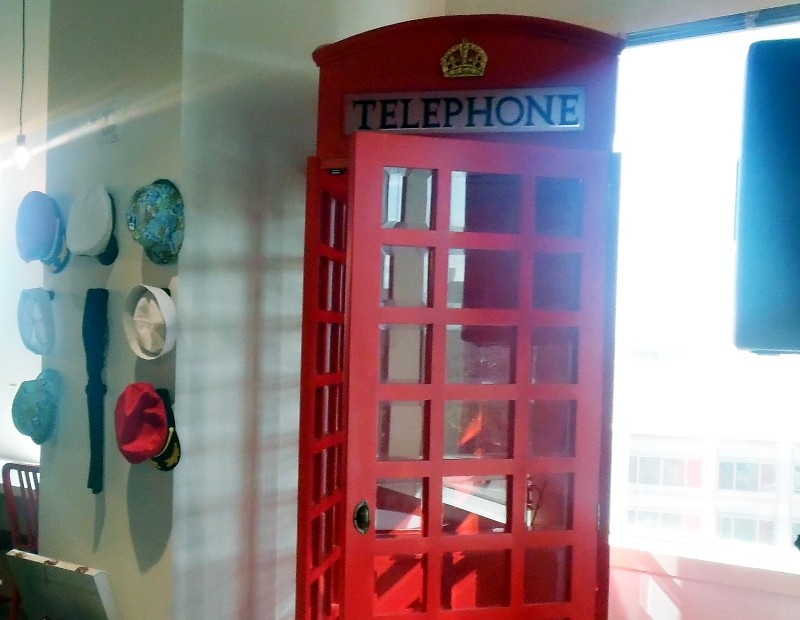 A symbolic British red phone booth is another design element.