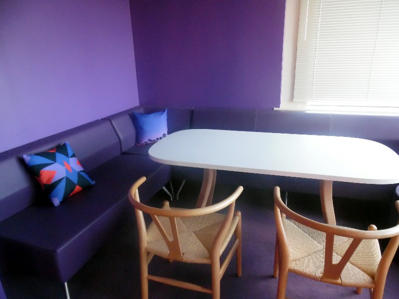 This small conference room has a purple look.