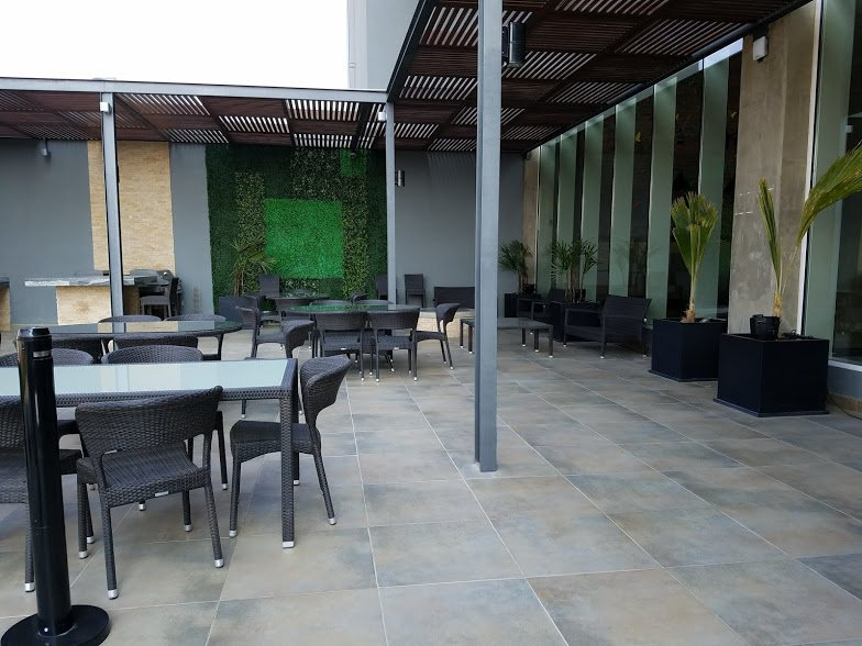 The patio outside has three fire pits, a full grill, an artificial green wall, a sports area and a pool.