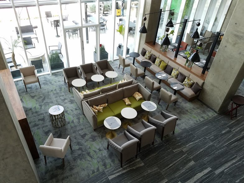 The two-story lobby of the Homewood Suites Silao has a full bar and restaurant.