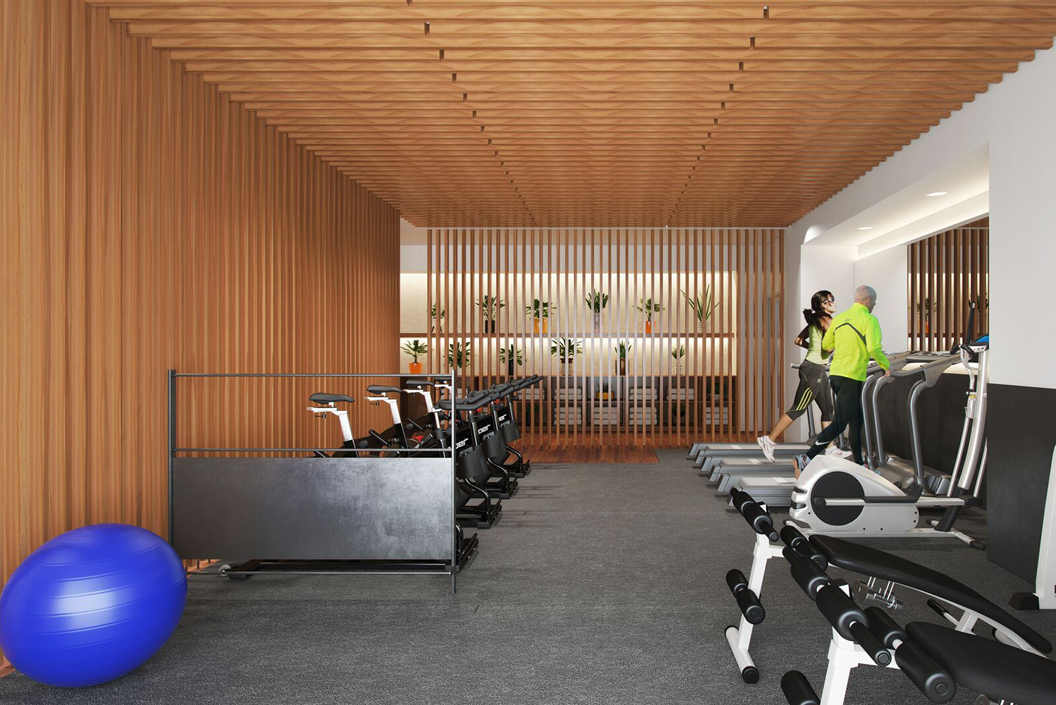 The gym has treadmills, stationary bikes and a designated free weight area.