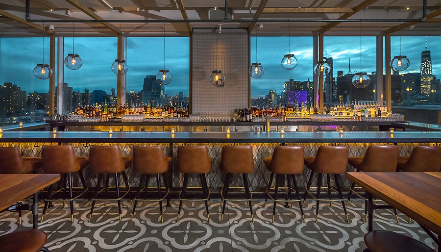 Mr. Purple, a rooftop bar and restaurant located on the 15th floor of the Hotel Indigo Lower East Side in New York, recreates an artist-loft ambiance with indoor and outdoor areas.