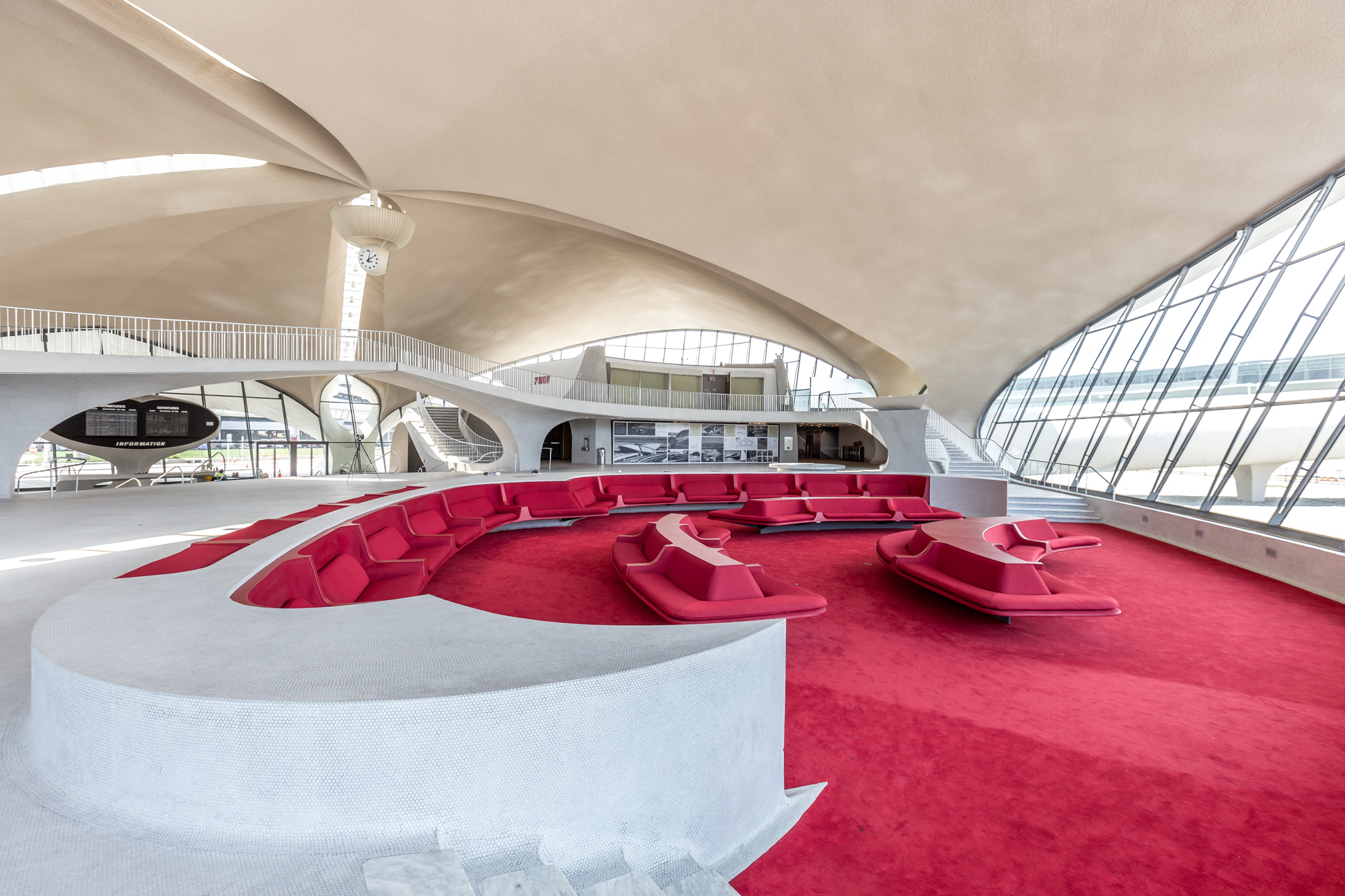 The TWA Flight Center evoked every element of 1960s style and the dawn of the jet age with its soaring ceilings and pedestrian tubes that let guests walk over the street to or from their gates.