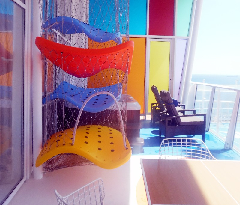 On the balcony, kids can climb on a three-dimensional vertical maze with netting.