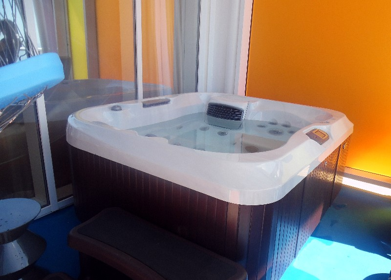 A hot tub awaits adults on the balcony of the Ultimate Family Suite
