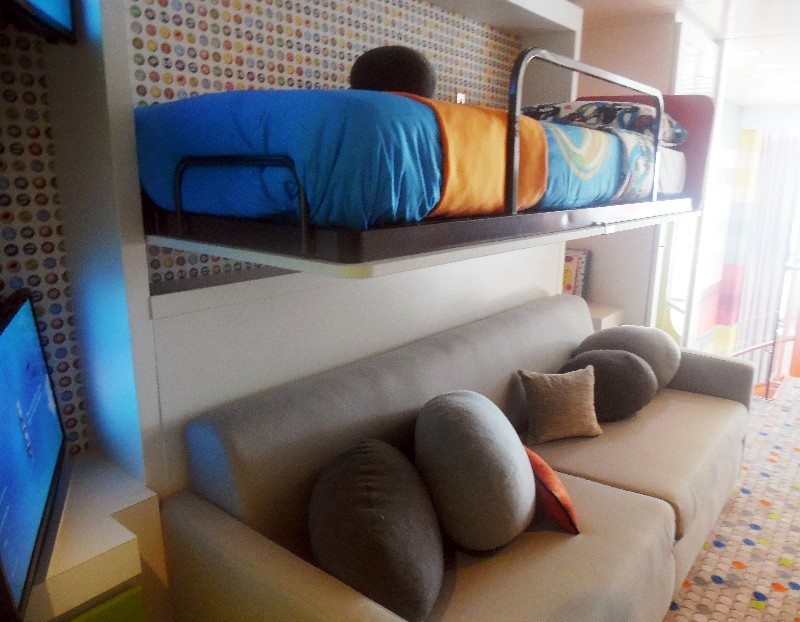 he children's bedroom has a pull out couch that sleeps two plus two twin bunks that hang from the walls (one shown here).