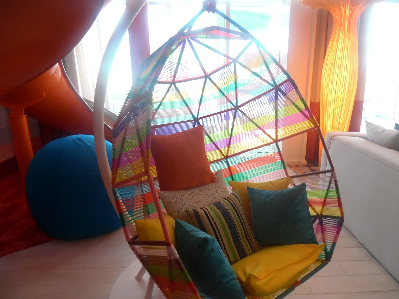 A swinging chair within the living area of the Ultimate Family Suite