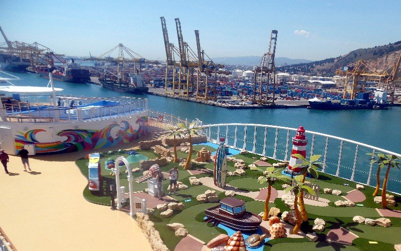 View from the Ultimate Family Suite's balcony to the putt-putt course and beyond to the Port of Barcelona, Spain
