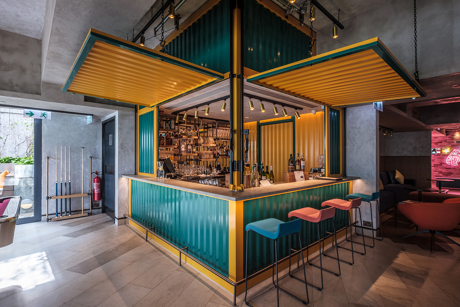 The container bar, one of two bars in the hotel, is made of corrugated metal and decorated with bright colors, paying homage to the shipping history of the area.