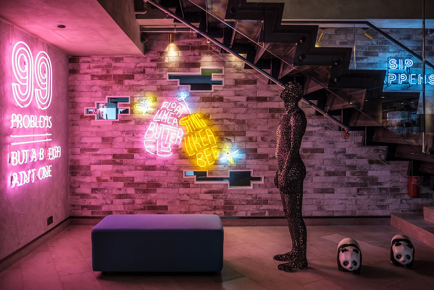 When entering the lobby, guests will be met with neon signs and colorful artwork.