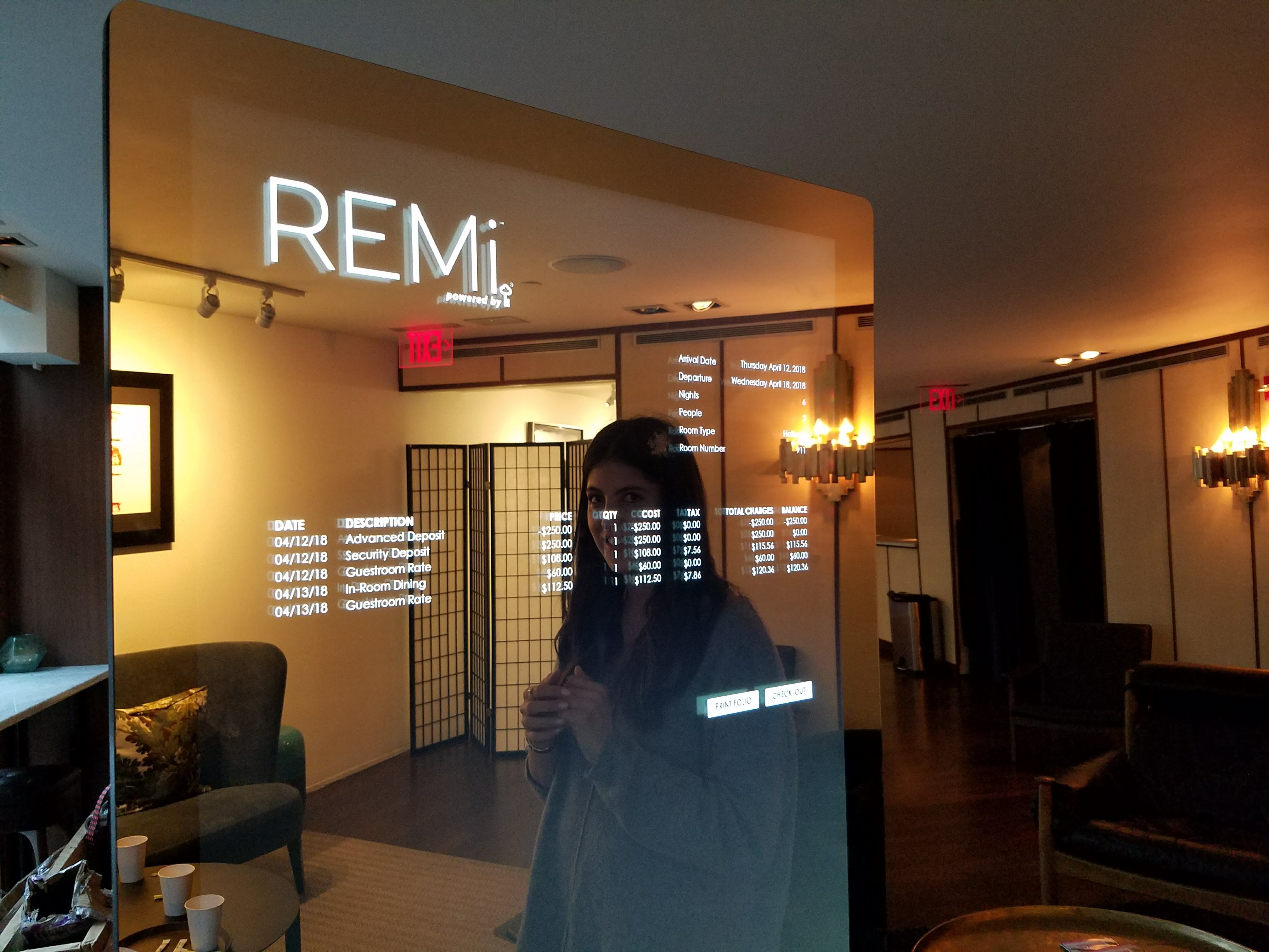 Paige Neugarten demonstrates how guests can use the Remi mirror to check out.