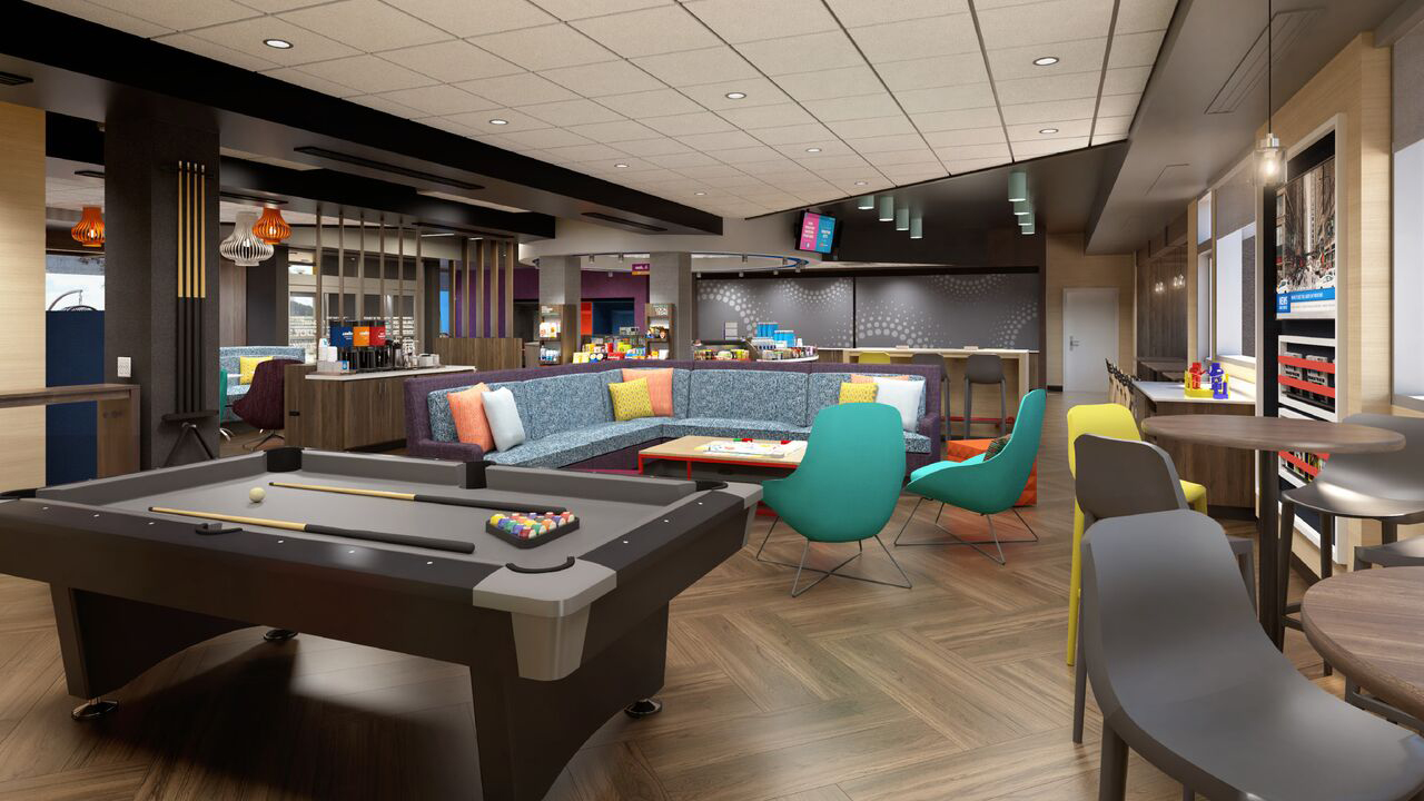 In the lobby, Tru has replaced the stadium-style seating with a large sectional sofa.