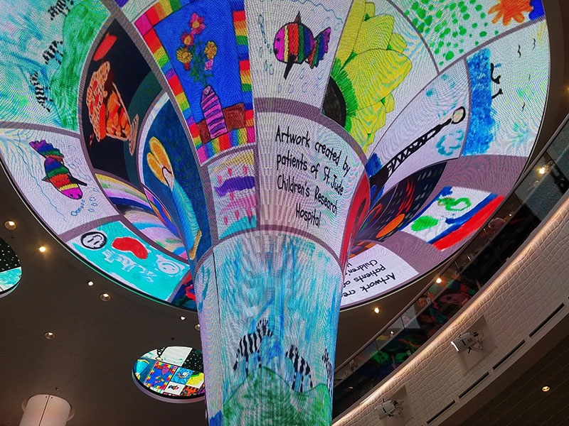 The Dreamscape funnel in the ship's atrium displays art by children from St. Jude's.