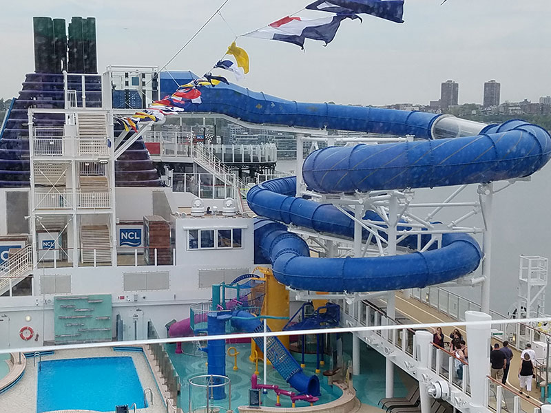 The ship's water park includes a kidde splash zone and a slide extending over the ocean.
