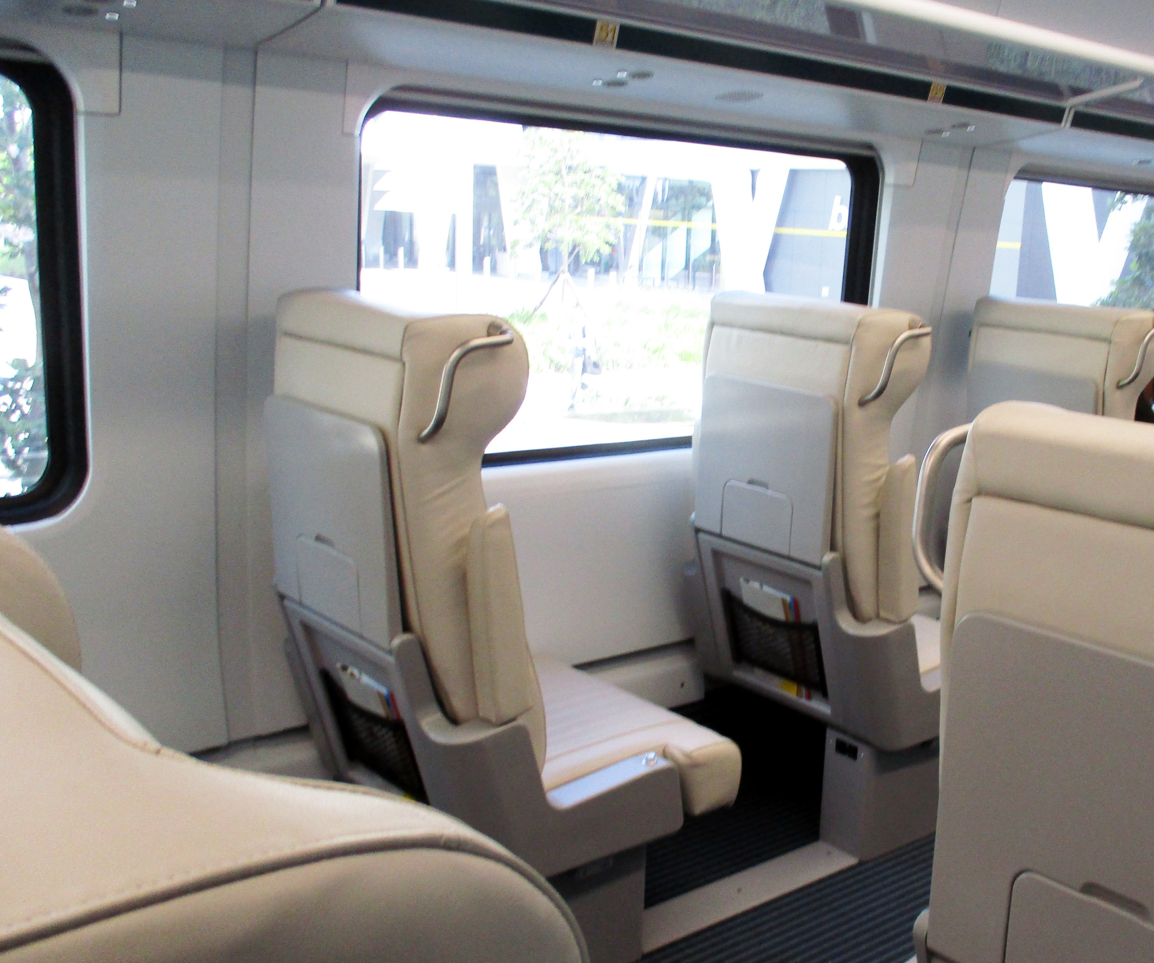 View to the single row of seats along one side of the train.