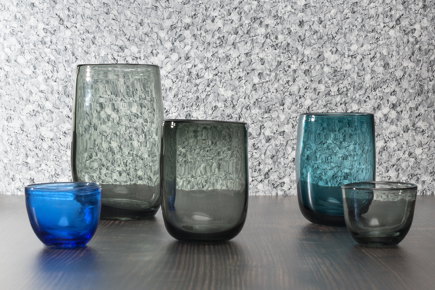 The collection includes Sapphire Ice, a large-scale stone design with white and blue veining.
