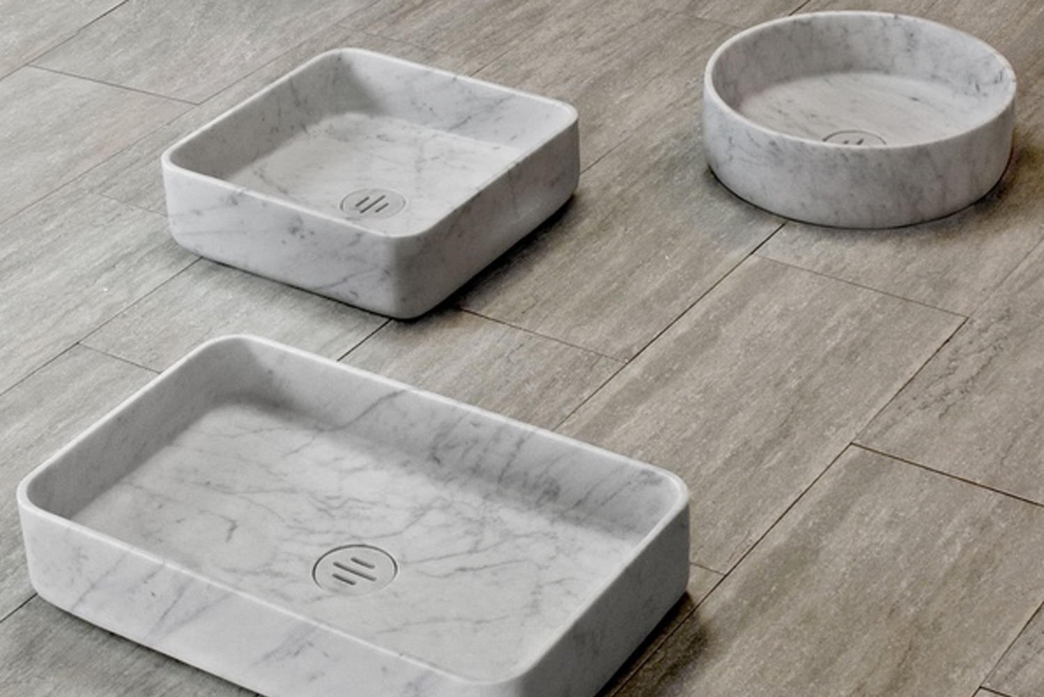 Slotted drain covers maintain the sleek, modern look of the sinks.