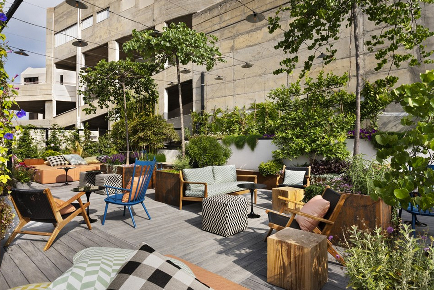 There is a hidden courtyard surrounded by greenery and concrete walls.
