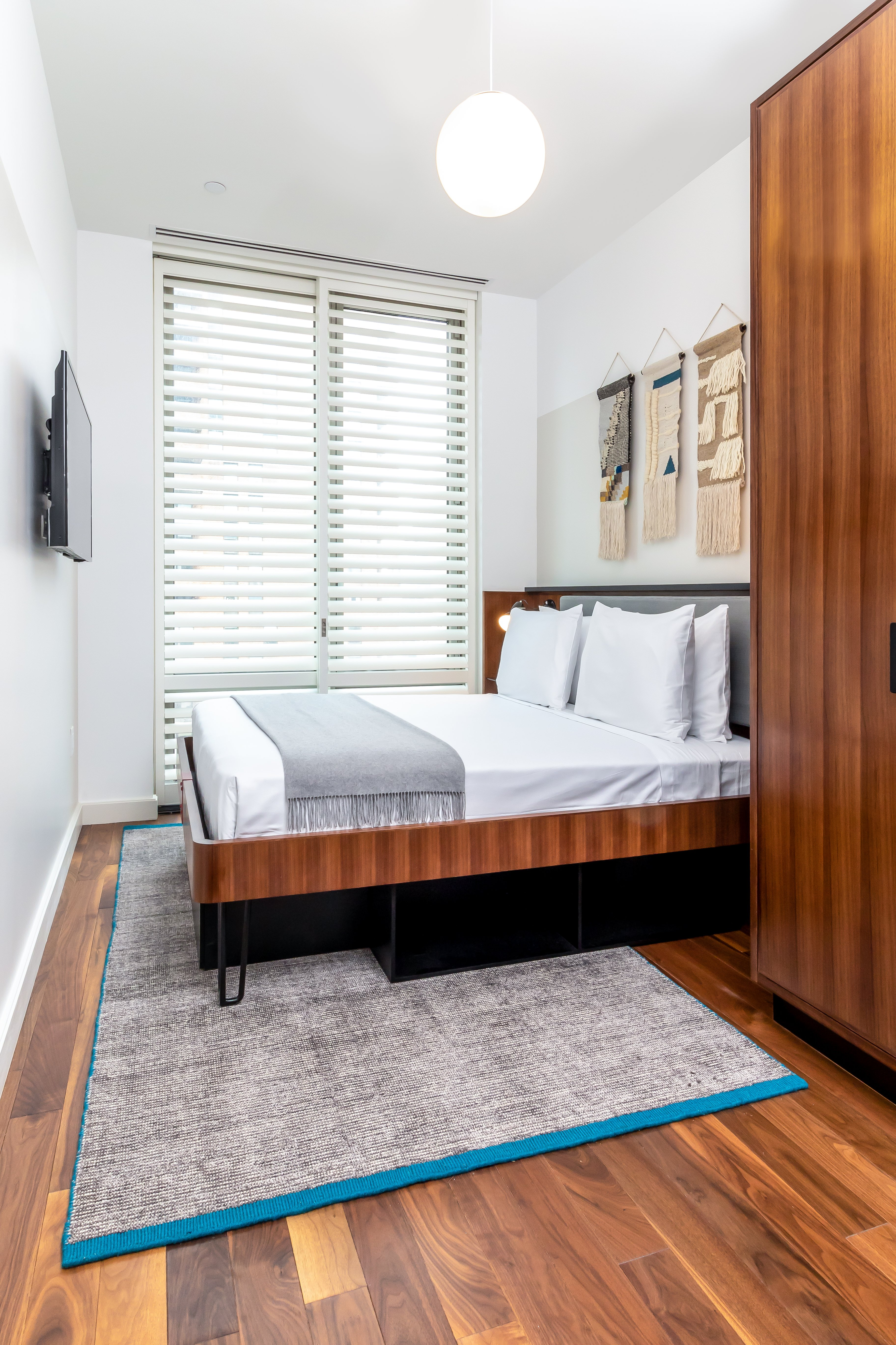 Like the Pod guestrooms downstairs, the Pod Pad bedrooms are small, but efficient.