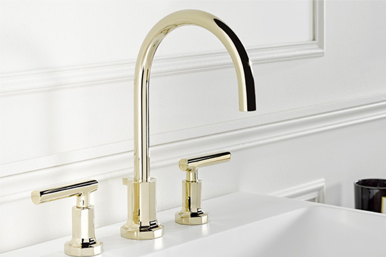 On top of the faucet's 10-sided faceted base sits a trident-shaped brace.