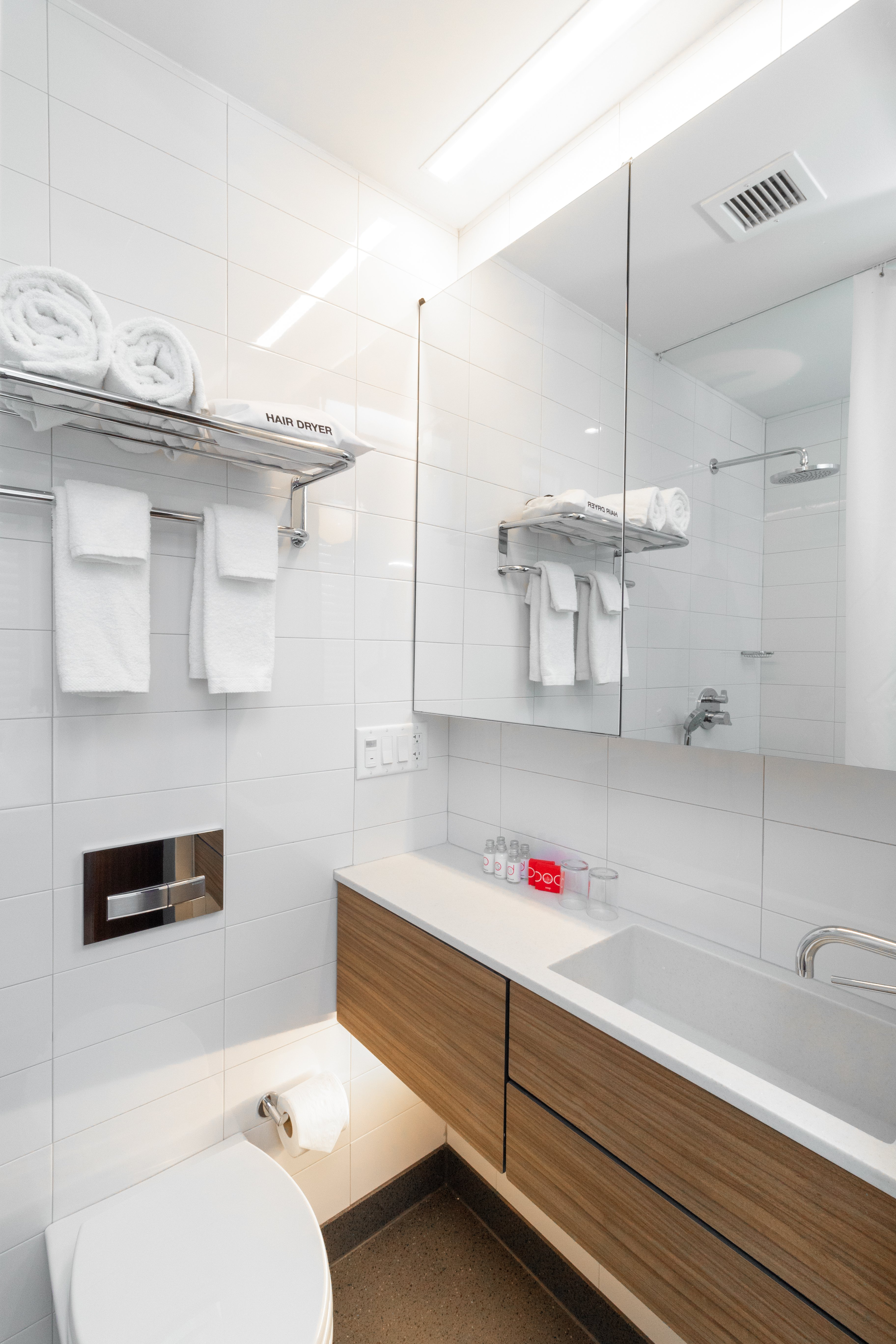 The bathrooms are made of stone, Corian, chrome and sliding glass doors.