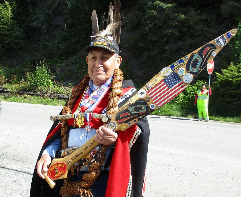A Tlingit elder and U.S. Marine Corps veteran greeted cruisers entering a Tlingit dance presentation in Kake. Photo by Susan J. Young