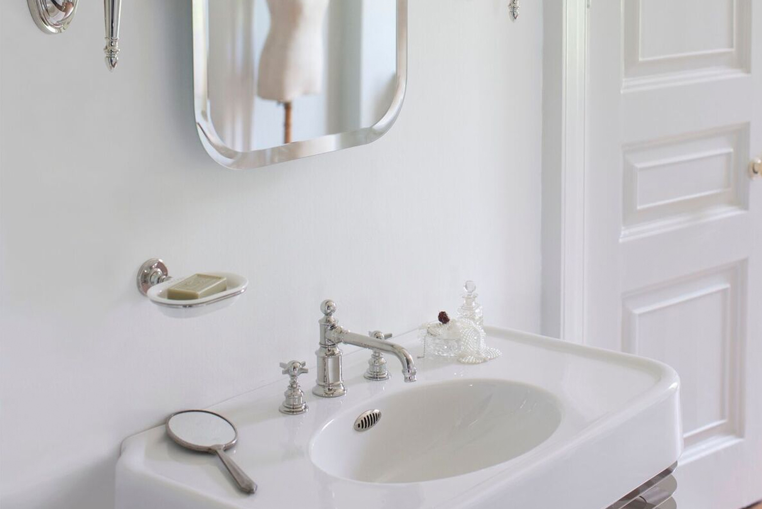 "Crosswater London added three new 24"" basin sets, two mirrors, a bath rack and a towel bar."